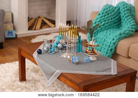 Beautiful Hanukkah decor on table in living room