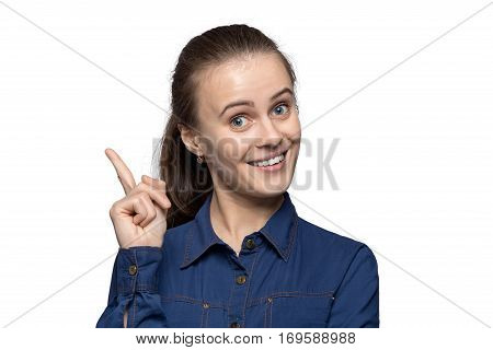 Portrait of woman with forefinger on white background