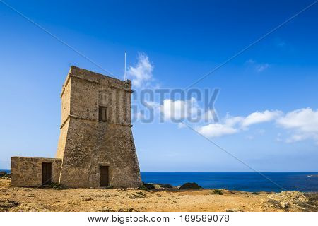 Malta - Ghajn Tuffieha watchtower at Golden Bay on a nice sunny summer day with clear blue sky