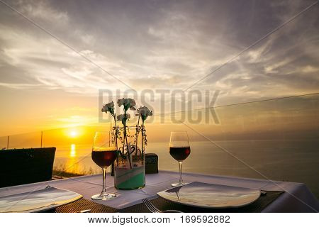 two glasses of wine on the background of the setting sun. Valentine's Day. romantic dinner for two.