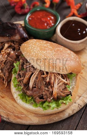 Pulled pork sandwich with ketchup and barbecue sauce