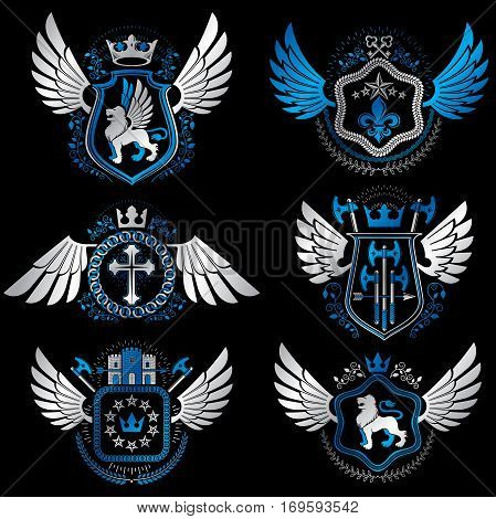 Heraldic emblems with wings isolated on white backdrop. Collection of vector symbols in vintage style created using heraldry elements like crowns towers crosses and armory.