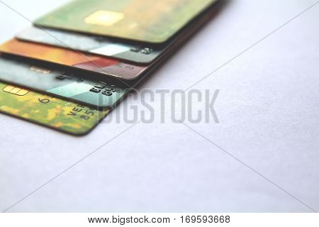 row of credit cards close up view with selective focus. horizontal background with copy space.
