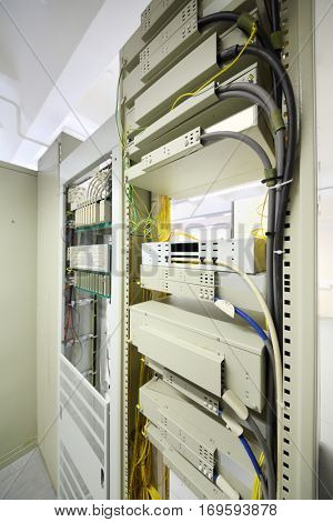 Telecom equipment with cables and switches in communication center