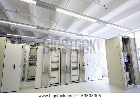 Telecom equipment in empty light modern communication center