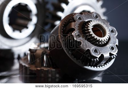 Machinery concept. Set of various gears closeup on dark background