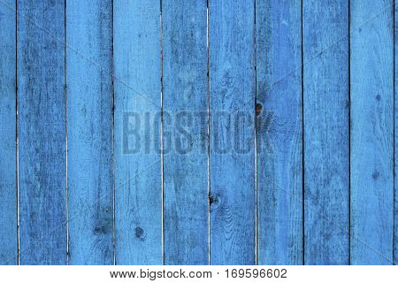 Old wooden painted blue rustic background paint peeling
