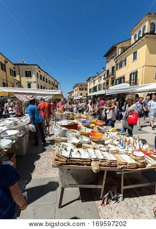 LAZISE ITALY - MAY 4 2016: The open air market in Lazise at Garda Lake. Italy