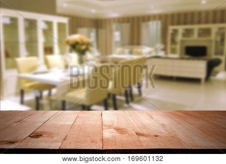 Wood table top with blur dinning room background used for montage or display your products