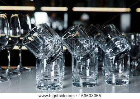 a lot of glasses of whiskey on the table