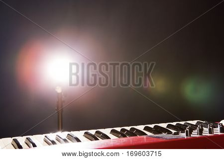 Piano in the dark background with light