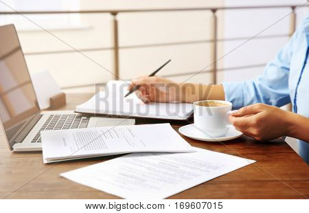 Lawyer sitting at the table with papers