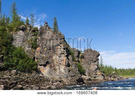 Fantastical cliffs on the river. Eastern Siberia. Krasnoyarsk Territory