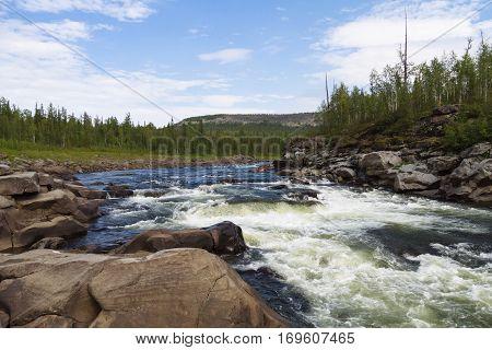 Fantastical cliffs and rapids on the river. Eastern Siberia. Krasnoyarsk territory
