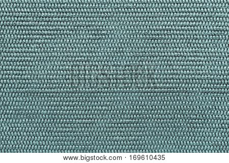 abstract textured background of pale blue green color of polymeric material with a symmetric pattern and with small drops of water