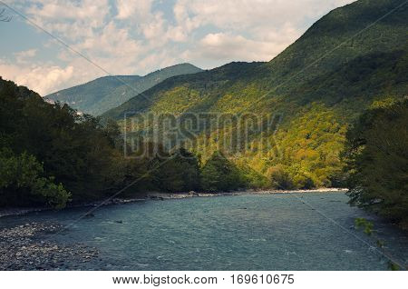 River in the mountains, originating in the high mountain lake.