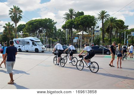 NICE, FRANCE - JUL 24, 2016: Police on bicycles, After terrorist attack July 14, 2016 in Nice to reinforce patrolling tourist places
