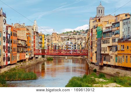 Yellow, red and orange facades of houses in Girona and Cathedral. Spain, Catalonia.