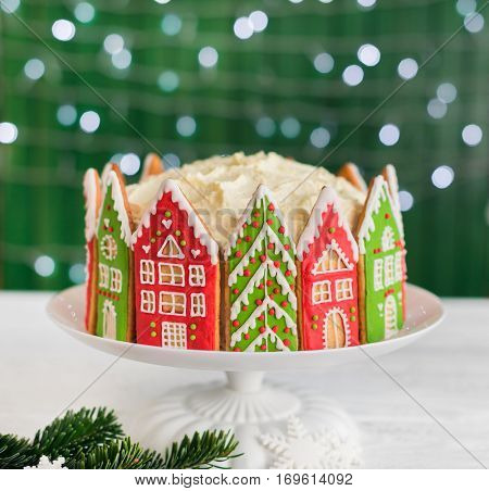 Christmas cake decorated with gingerbread cookies. Christmas houses.