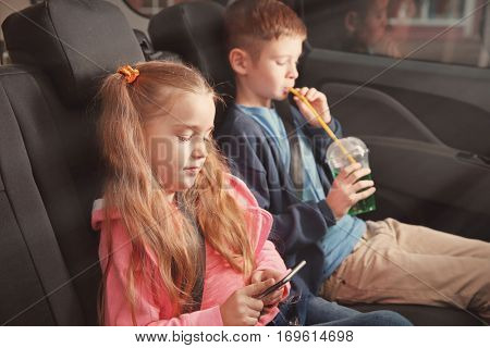 Little boy and girl sitting in a car