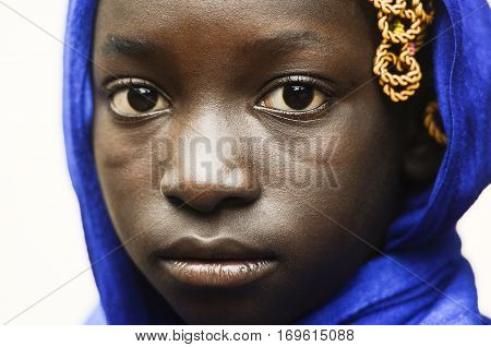 Young african girl in head scarf looking at camera isolated on white background