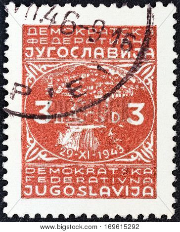 YUGOSLAVIA - CIRCA 1945: A stamp printed in Yugoslavia shows town of Jajce and inscription 29-XI-1943, circa 1945.
