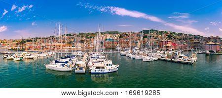 Panorama of marina Porto Antico Genova, where many sailboats and yachts are moored, Genoa, Italy.