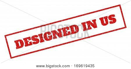Red rubber seal stamp with Designed In Us text. Vector caption inside rectangular shape. Grunge design and unclean texture for watermark labels. Inclined emblem.