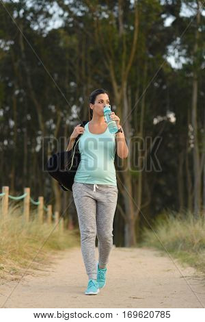 Pregnant Sporty Woman Drinking Water After Outdoor Workout