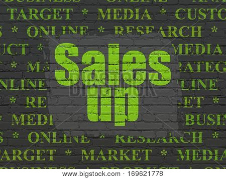 Advertising concept: Painted green text Sales Up on Black Brick wall background with  Tag Cloud
