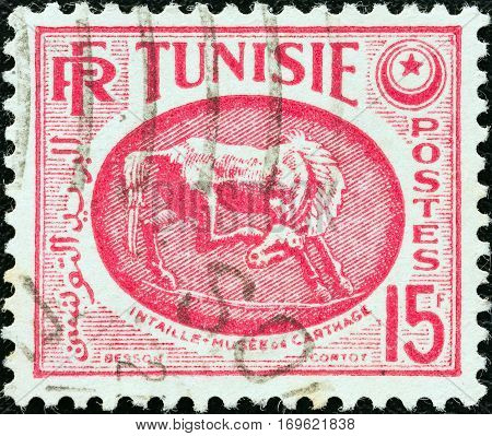 TUNISIA - CIRCA 1950: A stamp printed in Tunisia shows Horse (bas-relief), Carthage Museum, circa 1950.