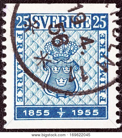 SWEDEN - CIRCA 1955: A stamp printed in Sweden issued for the centenary of first Swedish postage stamps shows the design of the first Swedish postage stamp, circa 1955.