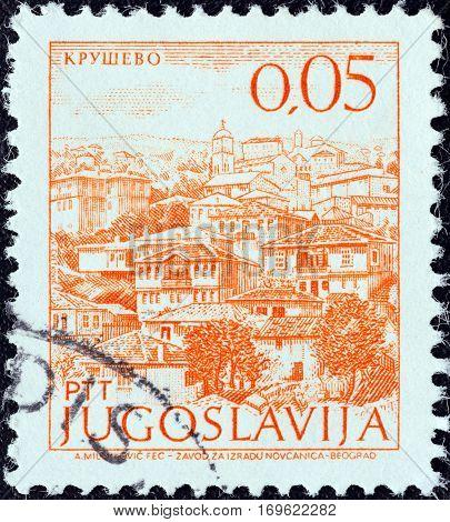 "YUGOSLAVIA - CIRCA 1971: A stamp printed in Yugoslavia from the ""Tourism"" issue shows Krusevo, FYROM, circa 1971."