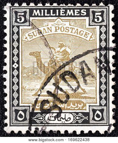 SUDAN - CIRCA 1921: A stamp printed in Sudan shows Arab Postman on camel, circa 1921.