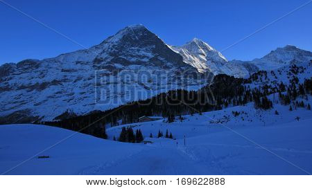Eiger north face in winter. Famous mountains Eiger Monch and Jungfrau.