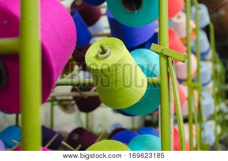 Spools of thread in the sewing equipment. The concept of sewing and textile production.