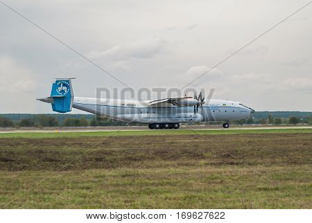 Kiev Region Ukraine - September 25 2008: Antonov An-22 turboprop cargo plane is taking off from the runway