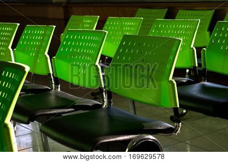 the group of chairs with green backrest and back light.