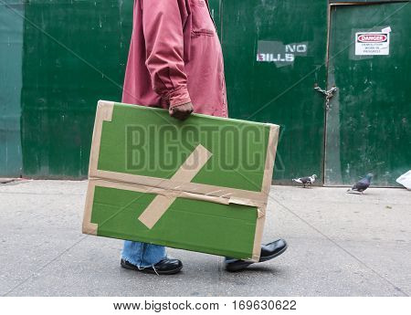 Woman With A Large Cardboard Package