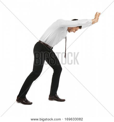 Businessman pushing invisible wall isolated on white