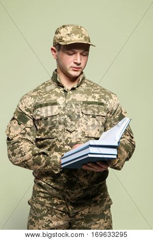 Cadet of military school on grey background