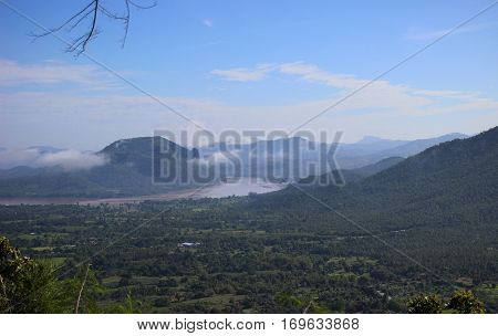 Mountain range and river in the morning.