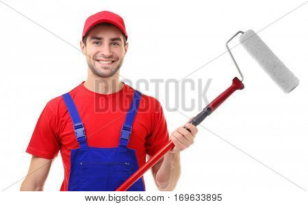 Handsome young decorator on white background