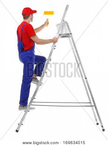 Handsome young decorator on ladder against white background
