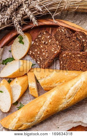 Fresh homemade bread in wooden bowl on table