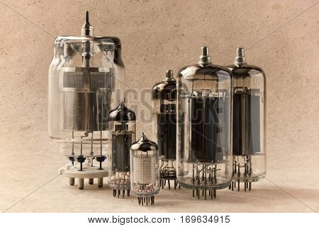 vintage electronic vacuum tubes on kraft paper background