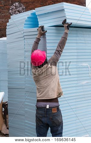 Worker Takes From Stock Necessary Amount Of Thermal Insulation Panels