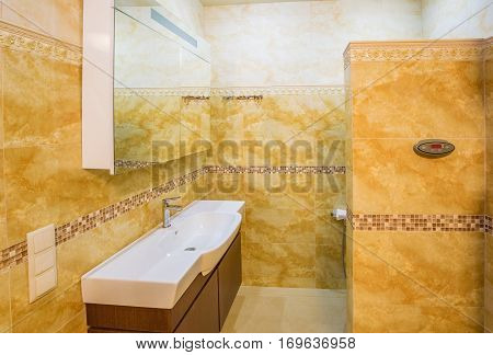 interior modern house, bathroom with marble tiles. Bathroom in beige tones
