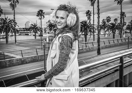 Smiling Young Woman In Barcelona, Spain Looking Into Distance