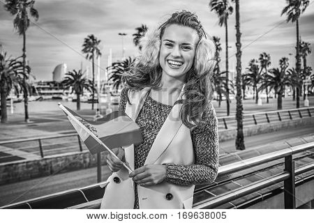 Fashion-monger On Embankment In Barcelona With Spanish Flag